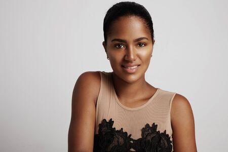 ethnic woman: black woman in studio shoot is smiling