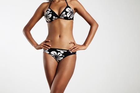 woman diet: woman with crossed legs wears bikini. season diet concept