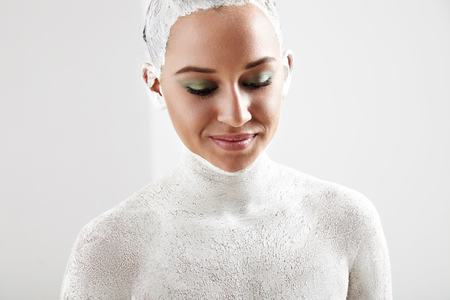 clarifying: woman with a white clay covered her body
