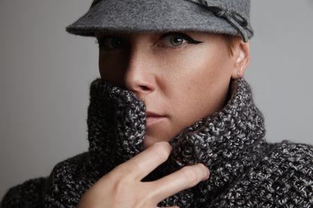 wears: woman wears warm cardigan. autumn image