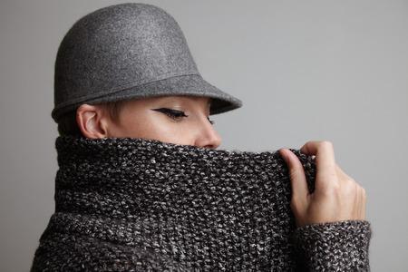 cardigan: woman put up collar of her wool grey cardigan LANG_EVOIMAGES