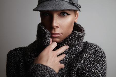 freezed: freezed woman wears coat and grey hat