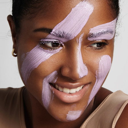 tratment: closeup of womans face with facial tratment product on it