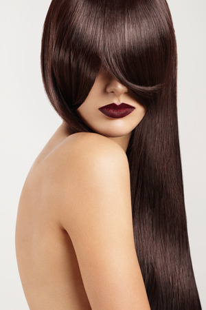 face covered: woman with face covered by ideal straight hair