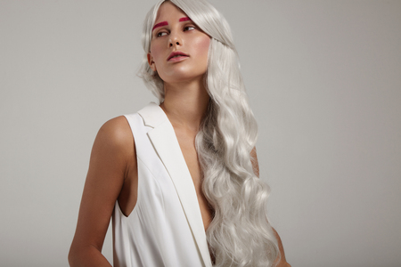 tratment: woman with grea gray hair, pink brows, creative professional hair tratment LANG_EVOIMAGES