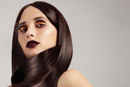 fair complexion: woman wears her straight hair like a scarf