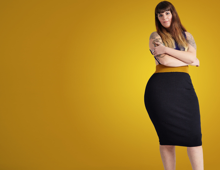 plus size model wears dress showing her curvy body