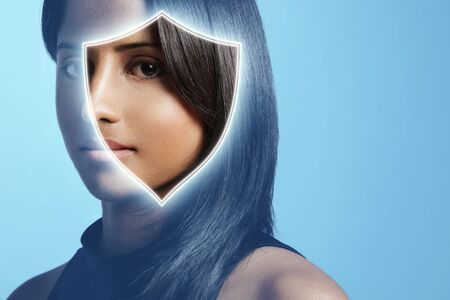 fair complexion: woman with shiny brunette hair watching at camera