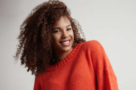 blonde teenager: happy smiling black womans portrait LANG_EVOIMAGES