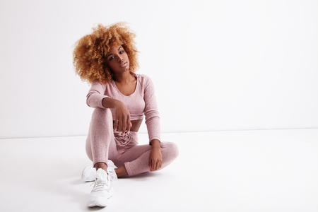 femenine: black woman with blonde curly afro hair