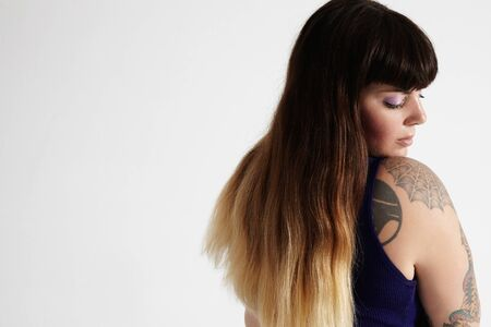 ombre: woman with tattoed arm and ombre hair