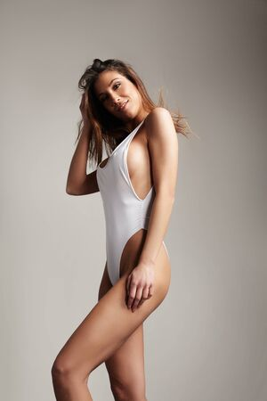 perfect fit spanish woman in swimsuit. straight hair LANG_EVOIMAGES