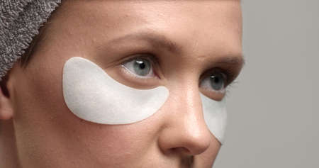 30s woman with an eye patches on closeup