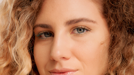 green eyed model with ideal skin closeup