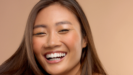 closeup portrait o asian thai japanese model happy laughing