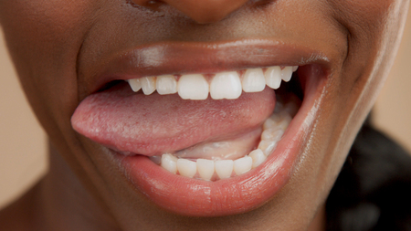 closeup shoot of black womans mouth with tongue out Stockfoto