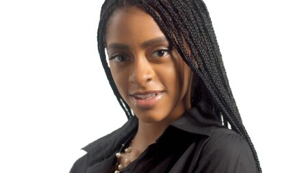 portrait of mixed race black woman with hair braids watching to the camera and smiling slightly 版權商用圖片