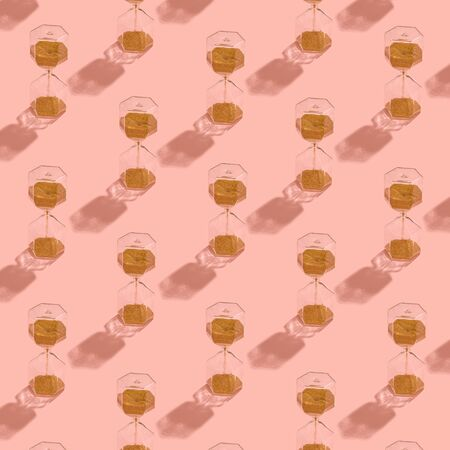isolated sand clock pattern on pink background Time concept square crop Stockfoto