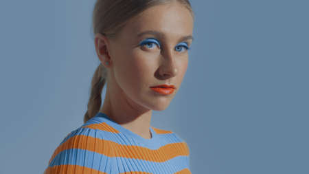 closeup portrait of young model with colorful makeup in blue tones Stockfoto
