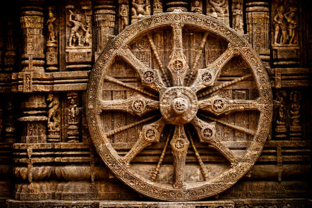 Beautiful chariot Wheel, Konark Sun Temple, Orissa Konark Sun Temple also known as the Black Pagoda is a 13th-century Temple at Konark, in Orissa. The entire temple has been conceived as a chariot of the sun god with 24 wheels, dragged by 7 horses. 에디토리얼