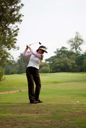 woman golf: A woman Golf Player hits her ball on the fairway during practice on the golf course of Tolly golf field, India