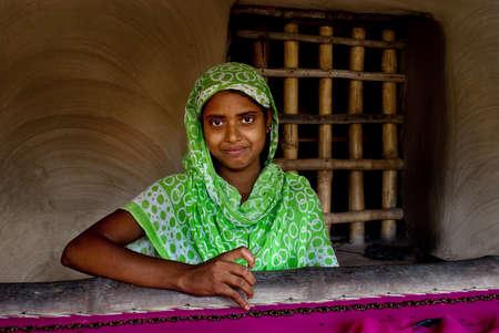 kolkata: Micro Finance: A rural Indian woman is busy with making hand-knighted garments at outskirts of Kolkata, India.