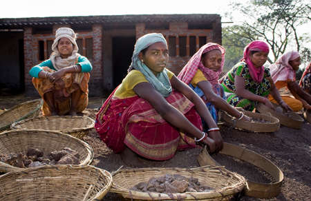 dearth: At rest: A group of Indian crusher labors are taking rest between their works.