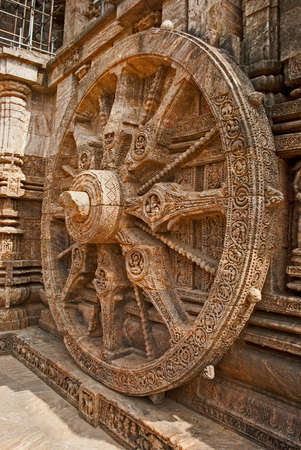 conceived: Beautiful chariot Wheel: Konark Sun Temple also known as the Black Pagoda is a 13th-century Temple at Konark, in Orissa. The entire temple has been conceived as a chariot of the sun god with 24 wheels, dragged by 7 horses.