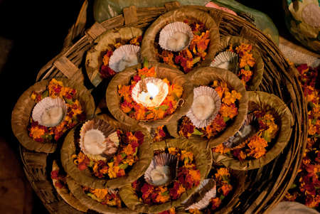 A basket full of floral candles to float as offerings is waiting for religious customers at Varanasi, one of worlds oldest living cities, is rightly called the religious capital of India