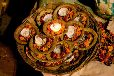 A basket full of floral candles to float as offerings is waiting for religious customers at Varanasi, one of worlds oldest living cities, is rightly called the religious capital of India. Editorial