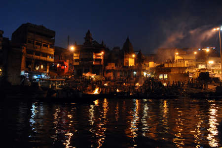 pyre: The Manikarnika Hindu cremation ghats on the Holy River Ganges (Ganga) in the sacred town of Varanasi (Benares) in the Uttar Pradesh region of northern India.