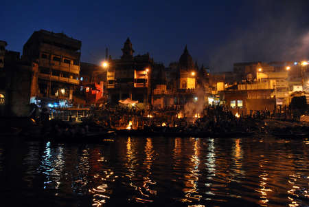 The Manikarnika Hindu cremation ghats on the Holy River Ganges (Ganga) in the sacred town of Varanasi (Benares) in the Uttar Pradesh region of northern India.