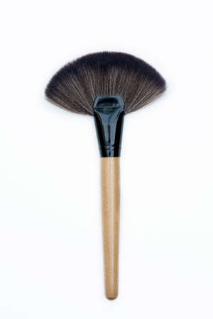 blending: top view of professional makeup brush on white backgrounds