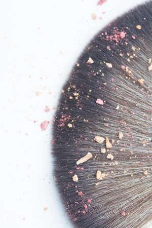 blusher: top view of close up lens blur makeup brush whit blusher crak