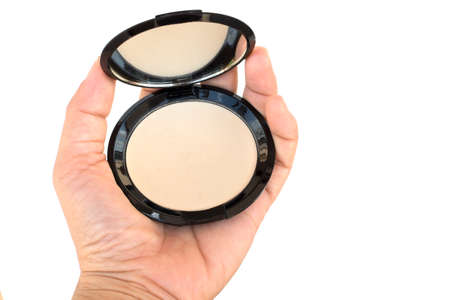 women's hand: isolated makeup pressed powder in womens hand