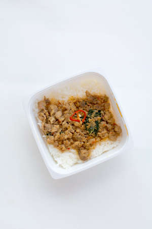 ready to eat: ready to eat,top view stir-fried basil pork with rice on white background Stock Photo