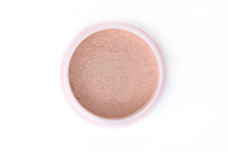 loose skin: top view beautiful skin tone loose powder for makeup on white background