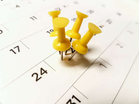 tripped: Calendar marked date with yellow pushpin  tripped pin.