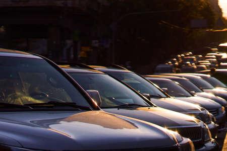 Several cars parked in a parking lot against sun rise Banco de Imagens