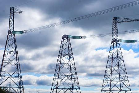 high voltage post.High-voltage tower sky background. Banque d'images - 130744900