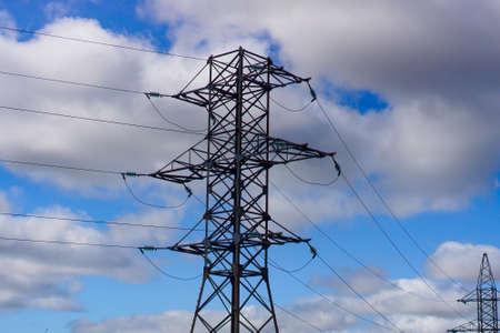 high voltage post. High-voltage tower sky background . Banque d'images - 130745374