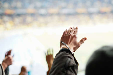 Football fans clapping on the podium of the stadium 版權商用圖片 - 130806065