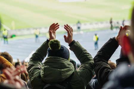 Football fans clapping on the podium of the stadium 版權商用圖片