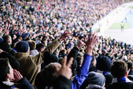 Football fans clapping on the podium of the stadium 版權商用圖片 - 130806136