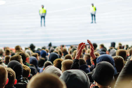 Football fans clapping on the podium of the stadium 版權商用圖片 - 130806150