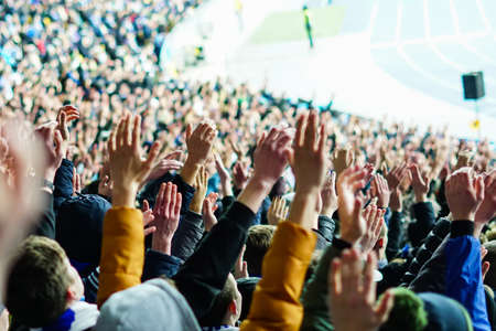 Football fans clapping on the podium of the stadium Foto de archivo - 130806189