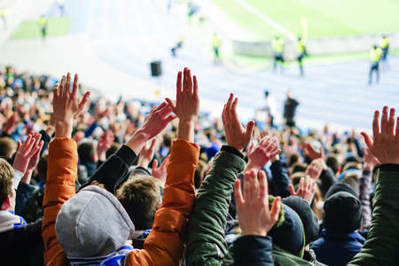 Football fans clapping on the podium of the stadium Foto de archivo - 130806247