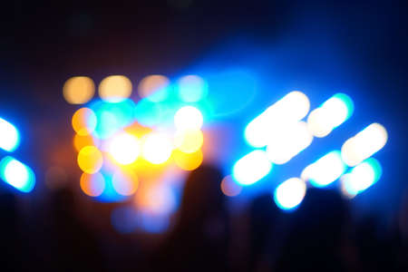 Defocused entertainment concert lighting on stage, blurred disco party. Stockfoto