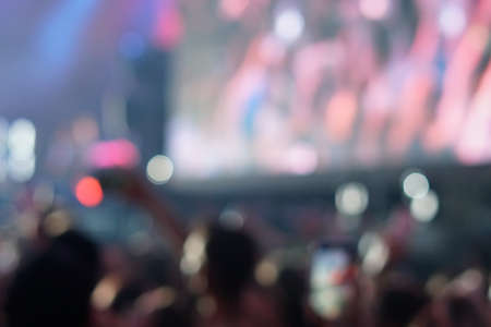 concert background, hand up , blurry background, beautiful bokeh live concert