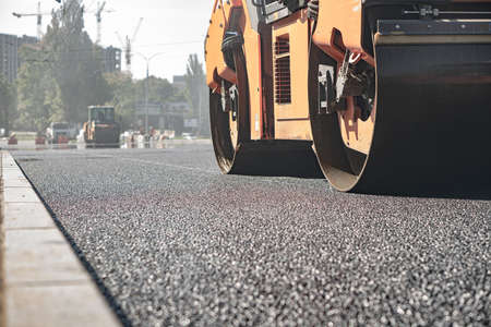 steamroller compact flatten out the asphalt tar 写真素材